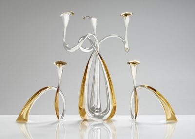 Three-armed anticlastic candelabrum with gold plating on inner curves. Two candlesticks.  Materials: Sterling Silver, gold plating