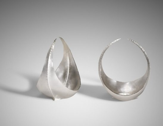'Side by side, Edge to Edge'. Pair of bowls made for the 'Side by Side. Edge to Edge' collection, a CBS collaboration with Finnish silversmiths. Each bowl is made from a folded and forged sheet; the fold is the decorative 'spine'. The foot is made of an inverted section, similarly folded.