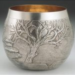 Hand raised silver and gilded bowl with images of the Cornish landscape.