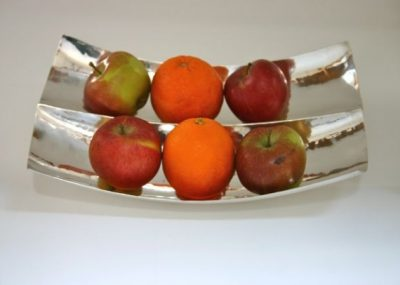 Centre piece bowl for fruit, chocolates biscuits etc. Hammered finish produces exciting and interesting reflections