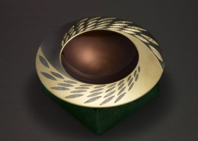 Silver, hand engraved / carved, black and yellow gilding, earth/bronze/brown enamel.  Base in green verdite. 150mm diameter   2007 reworked 2009