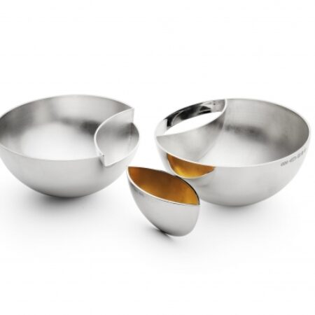 Interlocking bowls. Each bowl measures 100mm x 50mm and are spun from brittania silver(958). The connecting insert is gold plated to accommodate acidic food.