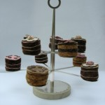 Silver, forged and turned cup cake stand with a shagreen covered base
