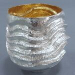 A deeply embossed beaker in fine silver with gilding. Height 130 mm 2019