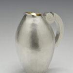 A hand raised Britannia silver jug. Height 215 mm.