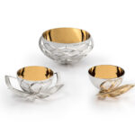 The 'Luxus' range is inspired by the natural leaf and petal formation of the majestic Lotus flower. These beautiful yet functional bowls have been created using a mixture of traditional silversmithing techniques, as well as CNC turning and rapid prototyping. The contrast in finishes on the pieces allow for an array of intriguing static reflections. The gold plated bowl offers versatility, allowing them to hold anything from salt and pepper, sugar, source/liquid to potpourri.