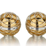 The Luxus range is inspired by the natural leaf and petal formation of the majestic Lotus flower and the principles of Fibonacci. The Luxus Salt & Pepper Grinders are a truly unique one of a kind pair, which marry pure luxury with form and function. The diamond set, part gilt, sterling silver grinders weigh approximately 1.25kg each, and are made using a mixture of traditional silversmithing techniques, as well as CNC milling and rapid prototyping. The pieces are highly engineered precision works of art and are fitted with adjustable ceramic grinding mechanisms which control the dispensed granule sizes of both the salt and pepper.