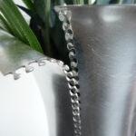 Unzipped Detail in Silver Vase.
