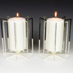 The Template candle holders are constructed out of sheet silver and are held together using a precision cut solid silver rod. The construction and assembly of each piece is engineered to be held together using just eight small stainless steel screws. The holders are designed to create a myriad of reflections as the highly polished surfaces catch the light whilst the candles are burning. They are designed around readily available non-drip Bolsius pillar candles and tealights and can hold a variety of candle styles and sizes. All the candle holders can be produced in a number of materials and finishes as well as different sizes.