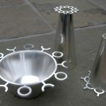 Silver Bowl with Matching Vases Silver bowl with two matching vases spun with forged decorative borders.