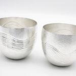 Chasing Waves Beakers, Britannia silver.