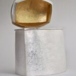Raised silver box gold leaf interior